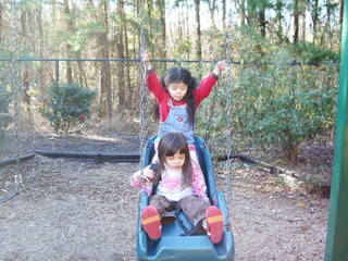 a&k on baby swing.jpg