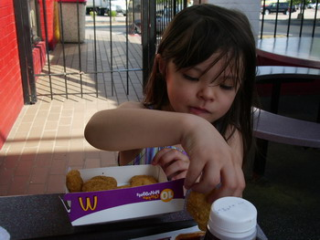 blog ayumi eating chicken nugget.jpg