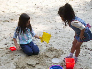 playing sand a bretwood park.jpg
